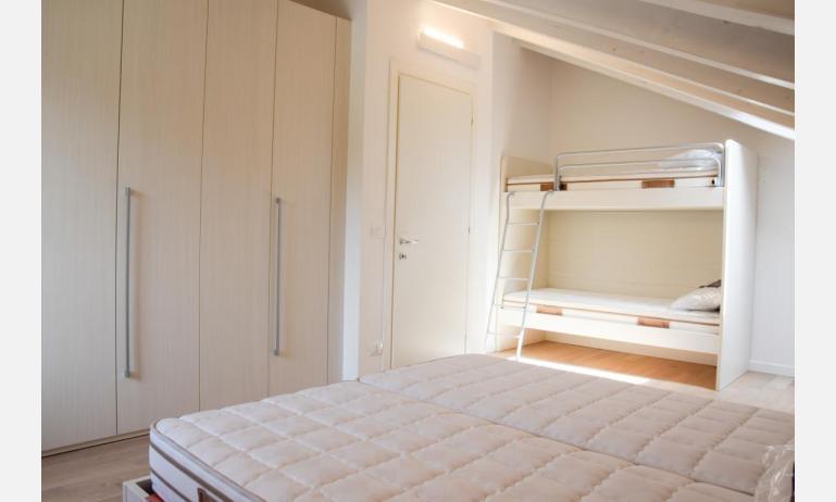 appartamenti Residenza GREEN MARINE: C8 - camera con letto a castello (esempio)